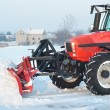 Tractor cleaning snow — Stock Photo