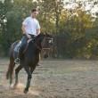 Young man riding  Horse — Stock fotografie
