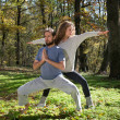 Girl and man doing yoga meditation — Stock Photo