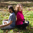 Girl and man doing yoga — Stock Photo