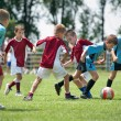 Stock Photo: Kids playing football