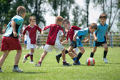 Kids playing football — Stock Photo