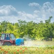 Tractor spraying wheat — Stock Photo #27032529