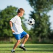 Child playing football — Stock Photo #27199065