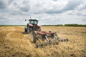 Tractor preparation the field — Stock Photo