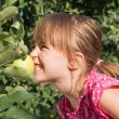 A little girl eat an apple — Stock Photo