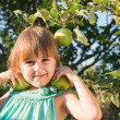 Happiness girl picking an apple — Stock Photo