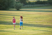 Two girls jogging — Stock Photo