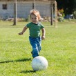 Little boy running with ball — Stock Photo