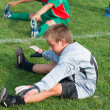 Goalkeeper kids football — Stock Photo
