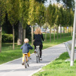Family riding bicycles — Stock Photo