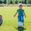 Kid's on football field — Stock Photo