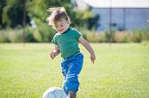 Little boy running with ball — Stock Photo