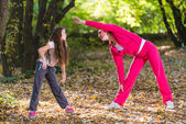 Exercising in a forest — Stockfoto