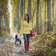 Girl with her dog — Stock Photo #34443593
