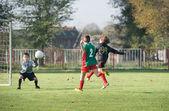 Boy kicking a ball — Stock Photo