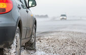 Car in a blizzard — Stock Photo