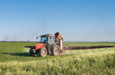 Tractor spraying pesticides — Stock Photo