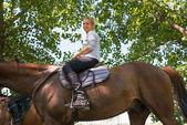 Girl on horseback riding — Stock Photo