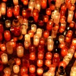 Stock Photo: Many burning candles in graveyard at night