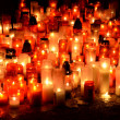 Many burning candles in graveyard at night — Stock Photo #13451318