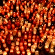Many burning candles in graveyard at night — Stock Photo