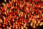 Many burning candles in graveyard at night — Stock Photo