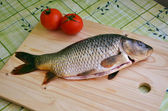 Fresh fish on the table (carp) — Stock Photo