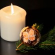 Christmas decoration with twig of spruce on the black background. — Stock Photo #16270333