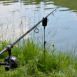 Close up photo of angling rod over the water — Stock Photo