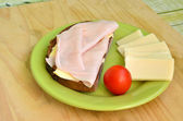 Tasty breakfast - slice of bread, ham and cheese — Stock Photo