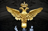 Golden double headed eagle as a russian national emblem — Stock Photo