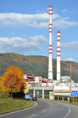 Old factory with two high chimneys next to the route — Stock Photo