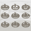 Set of Halloween pumpkins with scary smiles on gray background. Vector image. — Stock Vector