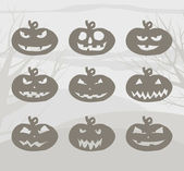 Set of Halloween pumpkins with scary smiles on gray background. Vector image. — ストックベクタ