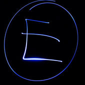 "Wavy symbol. Laser light alphabet. Symbol ""E"". — Stock Photo"