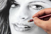 Drawing a portrait — Stock Photo