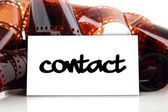 Contact - business card with old photographic film — Stock Photo