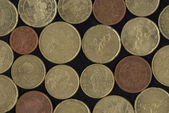 Euro coins on black background — Stockfoto