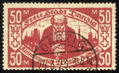 DANZIG - CIRCA 1923 A postage Stamp printing in Free City of Danzig (later Germany, now Gdansk, Poland) shows pensioner against the backdrop of the city , circa 1923 — Stock Photo