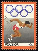 Polska - ok. 1969 po znaczek wydrukowany w polsce pokazuje biegacz, serii, ok. 1969 — Zdjęcie stockowe