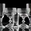 Closeup of some glasses on black background — Stockfoto