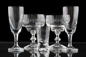 Closeup of some glasses on black background — Stock Photo