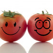 Funny tomatoes. Emoticons on white background. — Stock Photo