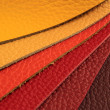 Natural leather upholstery samples with stitching in various colors — Stock Photo #25644047