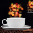 Stock Photo: Cup of coffee with coffee beans on beautiful background