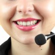 Young call-center assistant smiling at the camera — Stock Photo #29955565