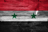 Wooden wall with Syria Flag — Stock Photo