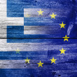 Greece and European Union flag painted on old wood plank background. The economic crisis in Greece — Stock Photo #30684373
