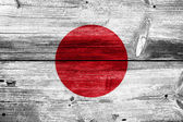 Japan flag painted on old wood plank background — Stock Photo